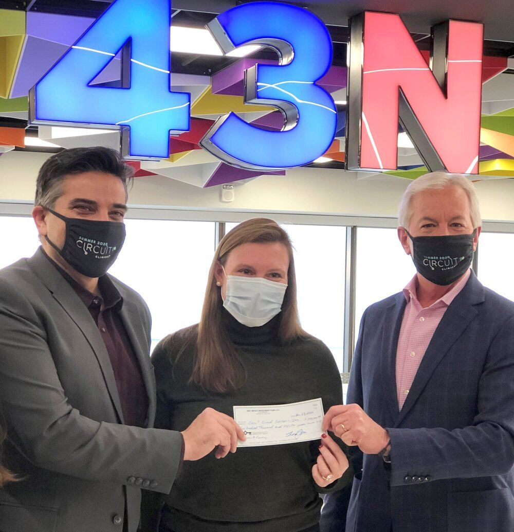 Thomas Quinn (CEO of the Western New York Impact Investment Fund) with Irfan Khan (CEO of Circuit Clinical) and Colleen Heidinger (President of 43North).