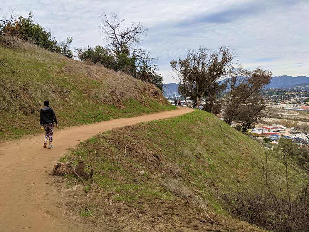 Woman walking on trail at Elysian Park in Los Angeles