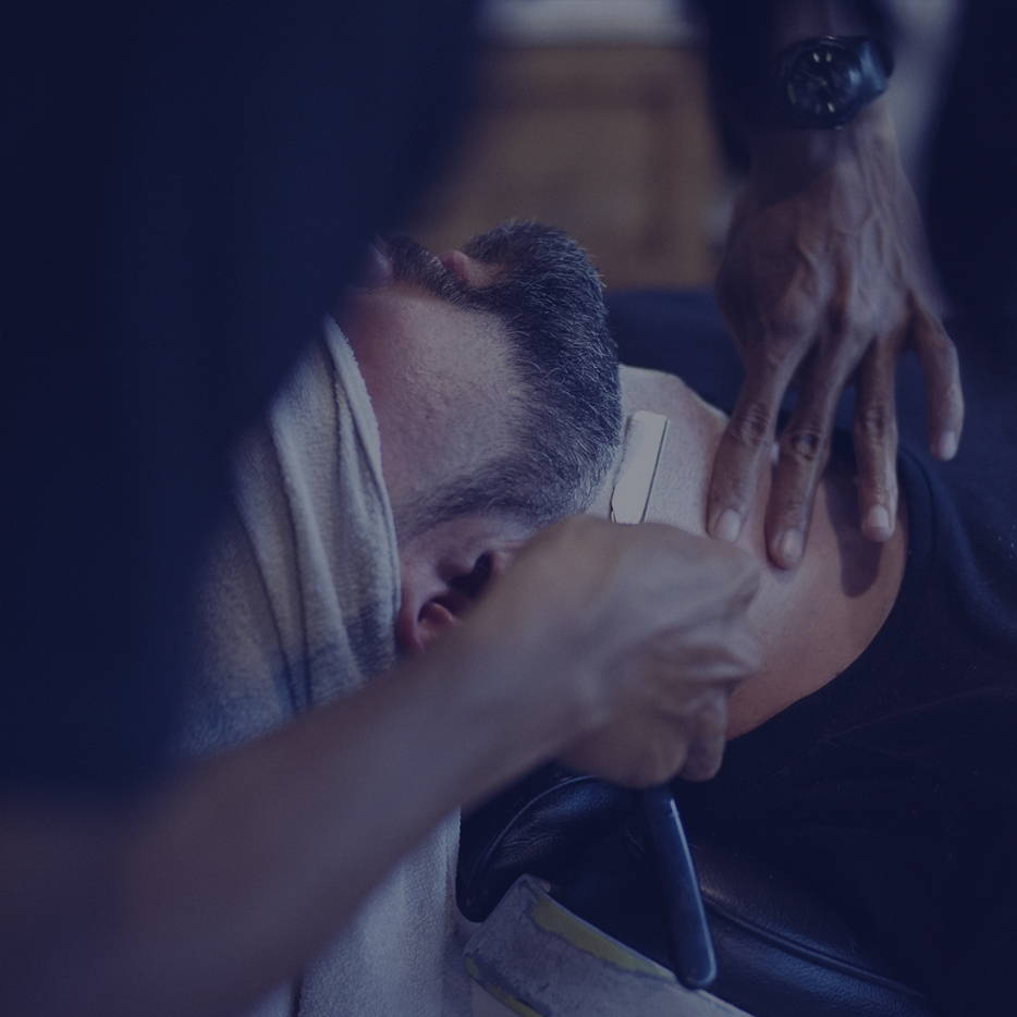Man receiving a cut throat shave