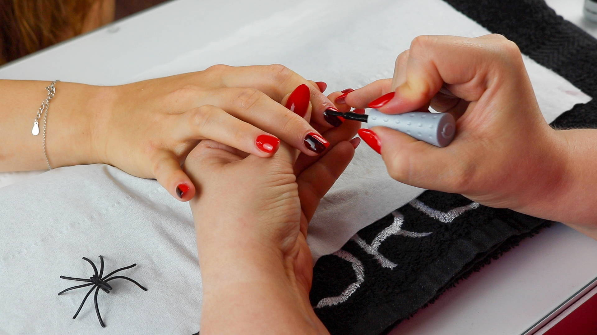 Nail stripe being painted onto nails using ORLY Liquid Vinyl to create Harley Quinn nails