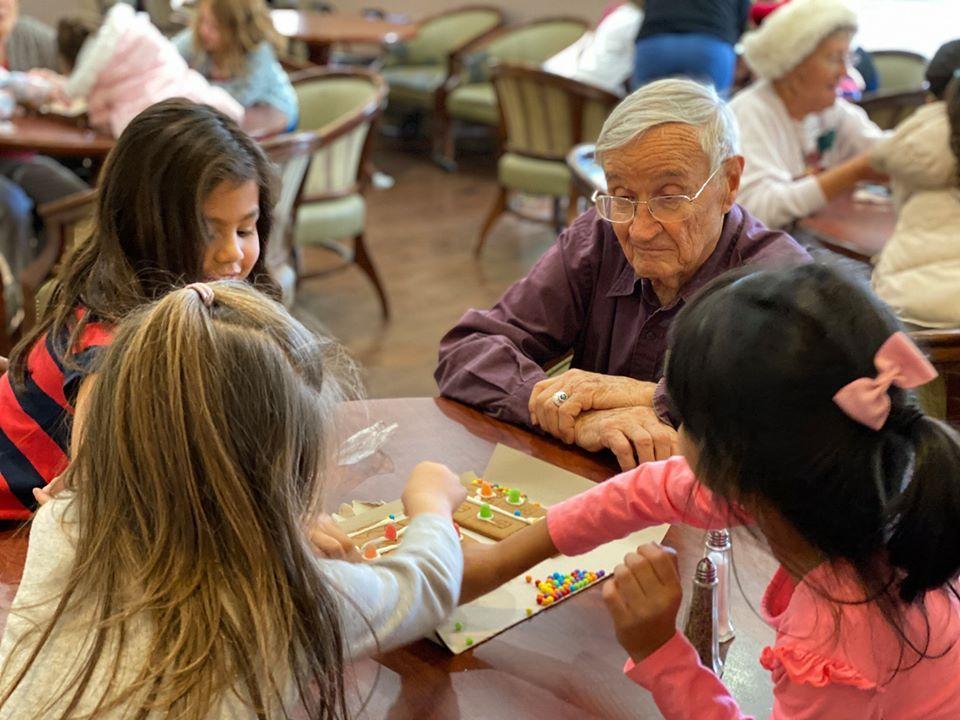 elderly man and three girls