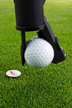The GameSaver golf putter grip places the golf ball and picks up the putt marker