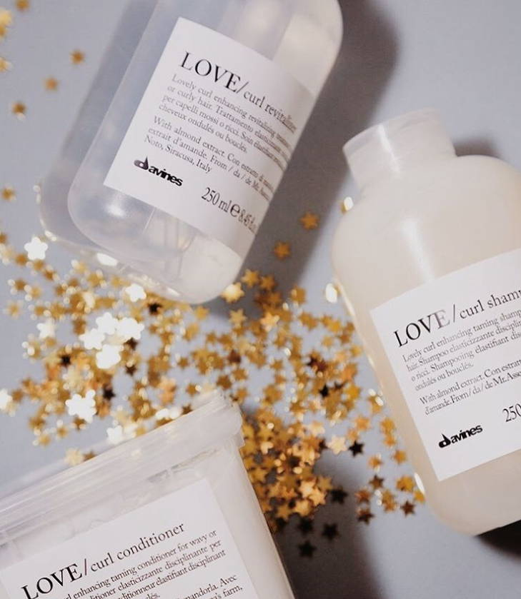 Davines LOVE Curl products with gold glitter