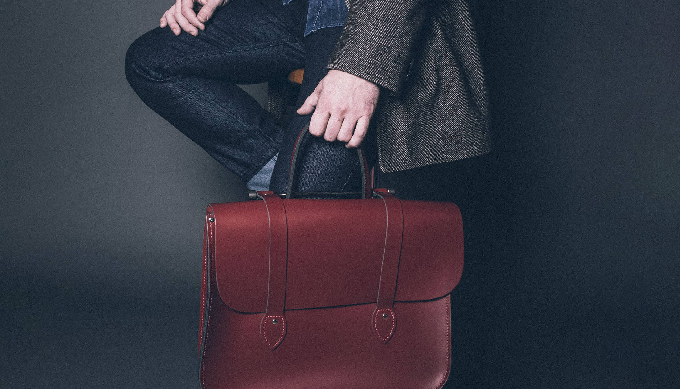 Model Holding a Red Leather Music Bag