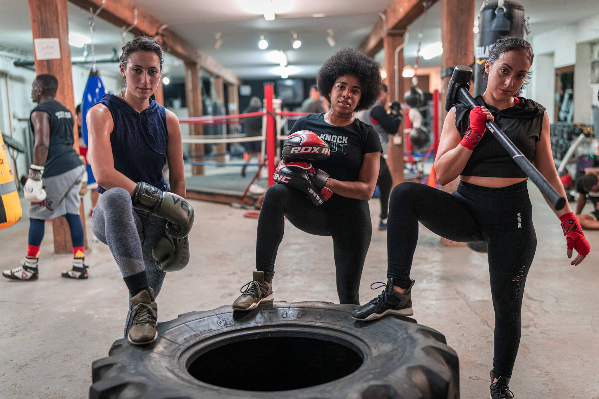 Julie, pictured with Raquel Harris and Jenna Ortiz at SouthBoX gym