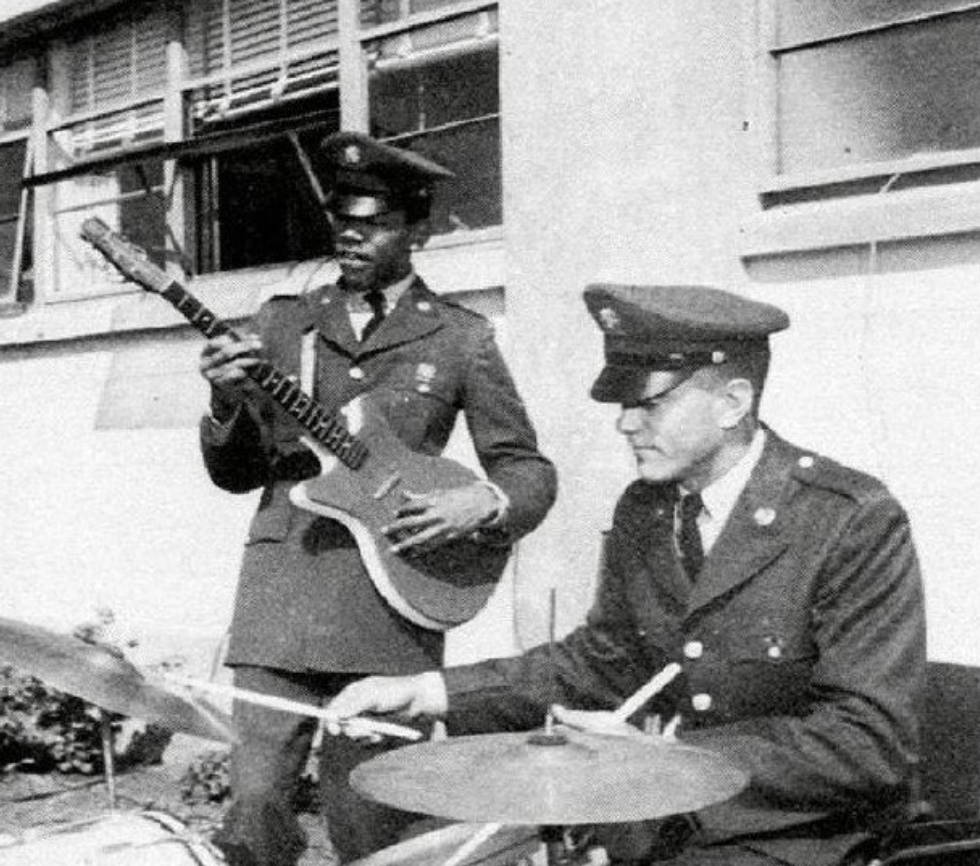 19 year old private Jimi Hendrix jamming with an army buddy 1961.