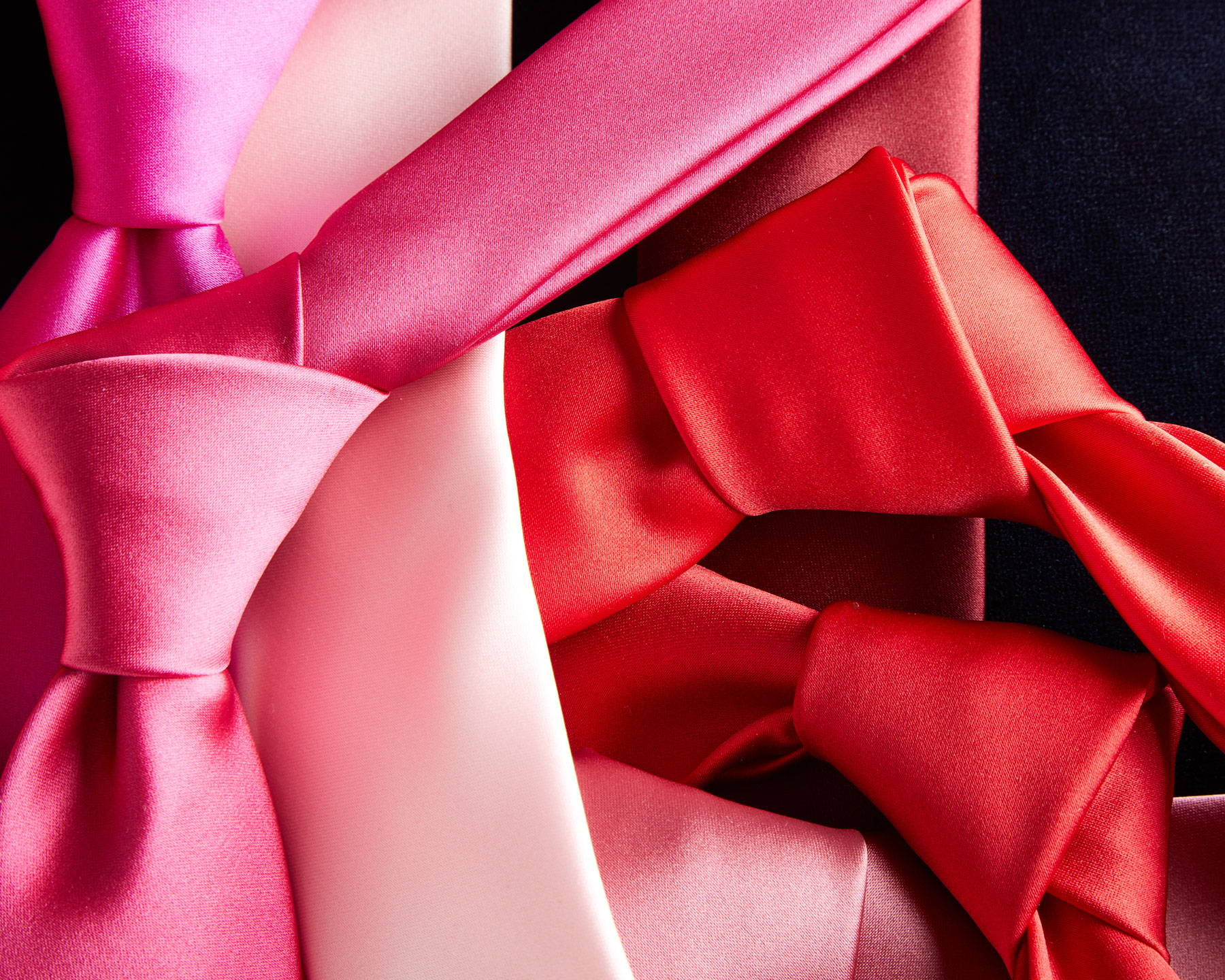 Pink and red ties laid flat