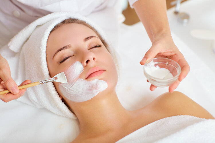 Woman being treated for medical grade peel and facial mask at  our Australian Skin Clinic.