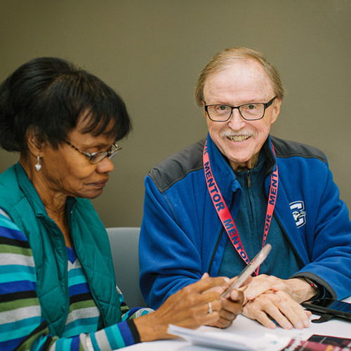 Picture of Cyber Seniors is a weekly drop-in tech help session where attendees can learn technology skills.