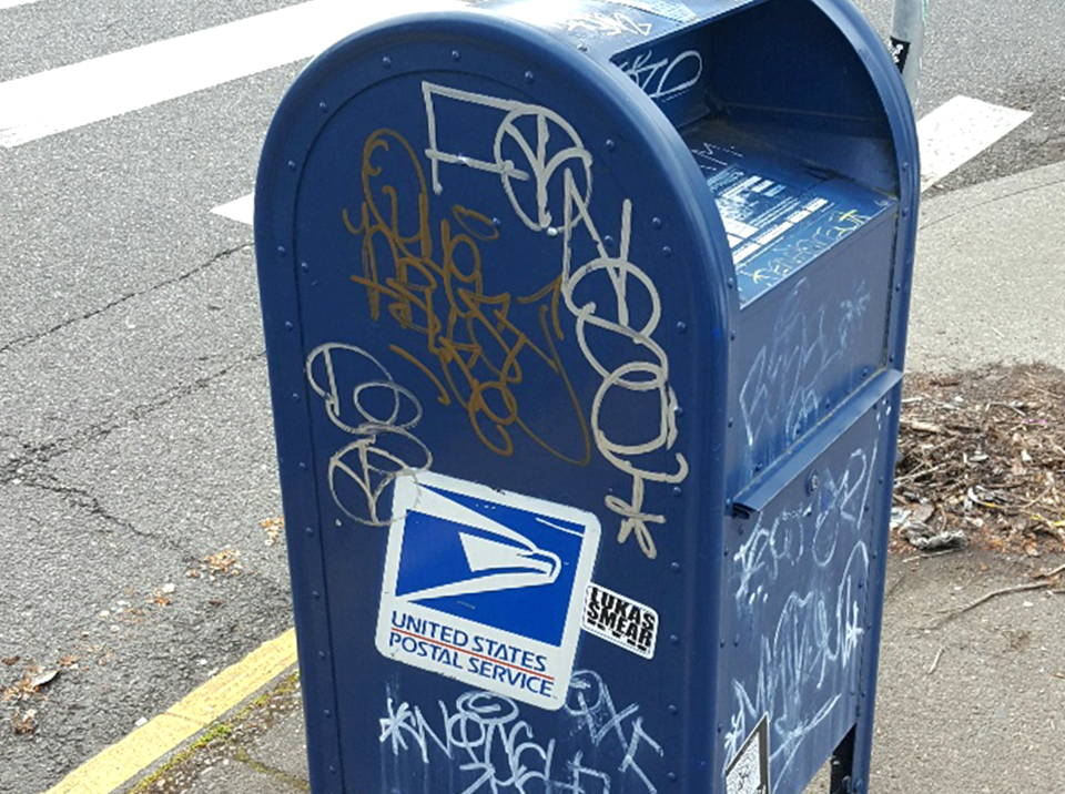 removing graffiti from us post office box