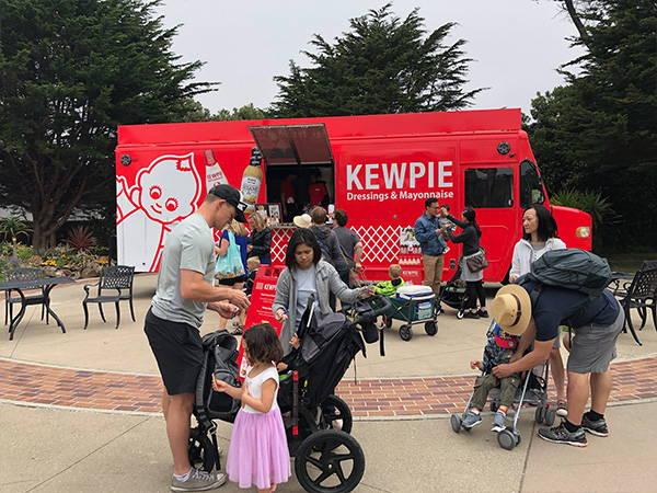 Families getting free food at the kewpie food truck