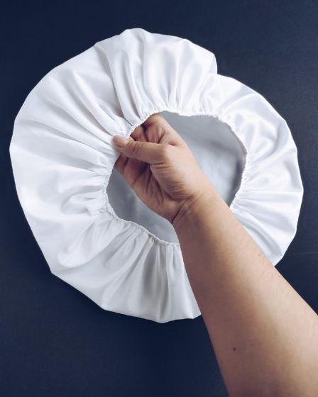 Шапочка для душа из водонепроницаемой ткани