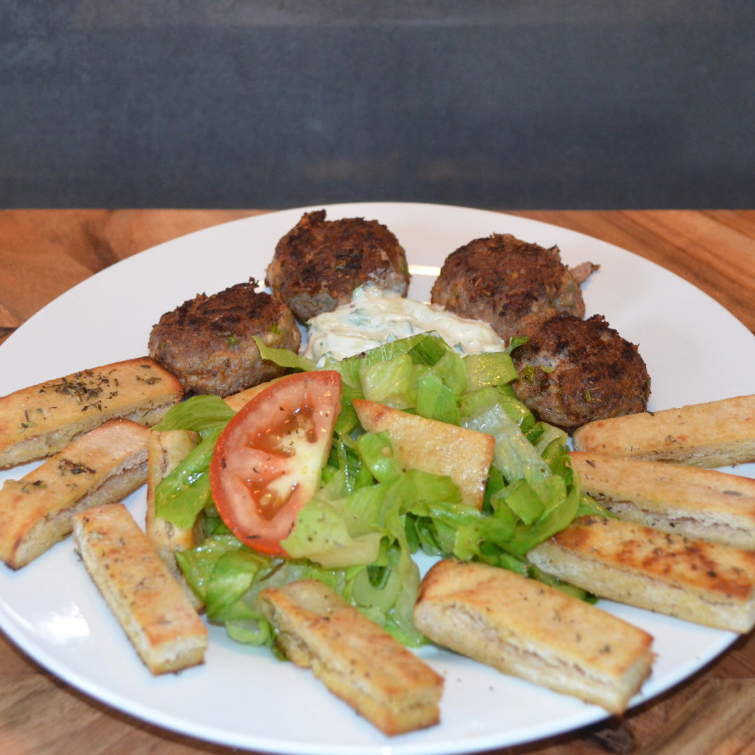 Date: 13 Mar 2020 (Fri) 82nd Main: Greek-Style Lamb Rissoles with Pita Salad & Tzatziki [270] [156.4%] [Score: 9.3] Cuisine: Greek Dish Type: Main Lamb mince is so rich and flavourful; it really ups the ante when it comes to rissoles. Inspired by Grecian eating at its best, this dish is part traditional fare with tzatziki, part modern innovation with herbed pita strips, crunchy and tasty in equal measure.