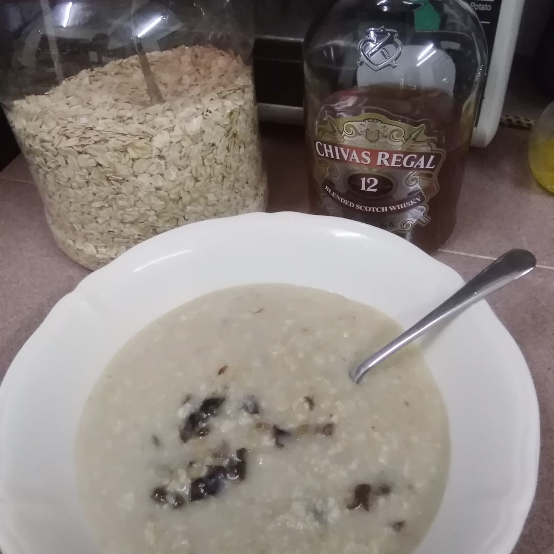 Cooked rolled Oatmeal with prunes and raisins