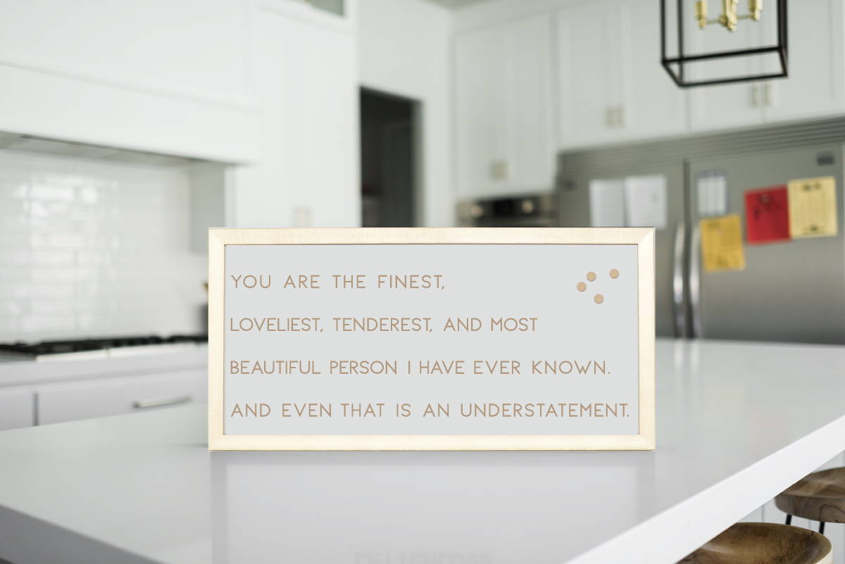 gold framed magnet board in kitchen