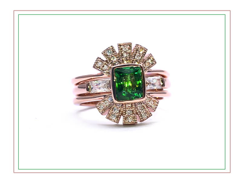 rose gold inca ring with diamond and emerald