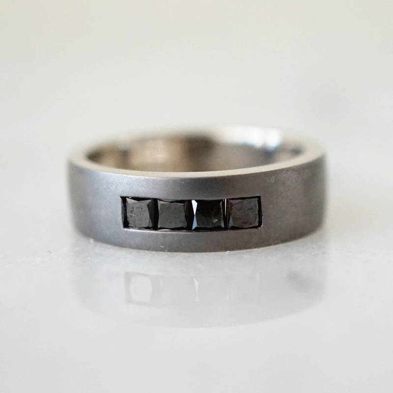 white gold band with black diamonds