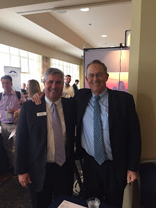 "T. Rowe's Steve Larson with Andy Hill, whose book ""Pyramid of Leadership"" is still used today."