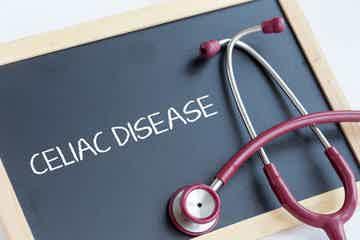 "A stethoscope with a chalkboard that reads ""Celiac Disease"""