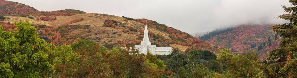 Bountiful Temple against mountains with fall trees.