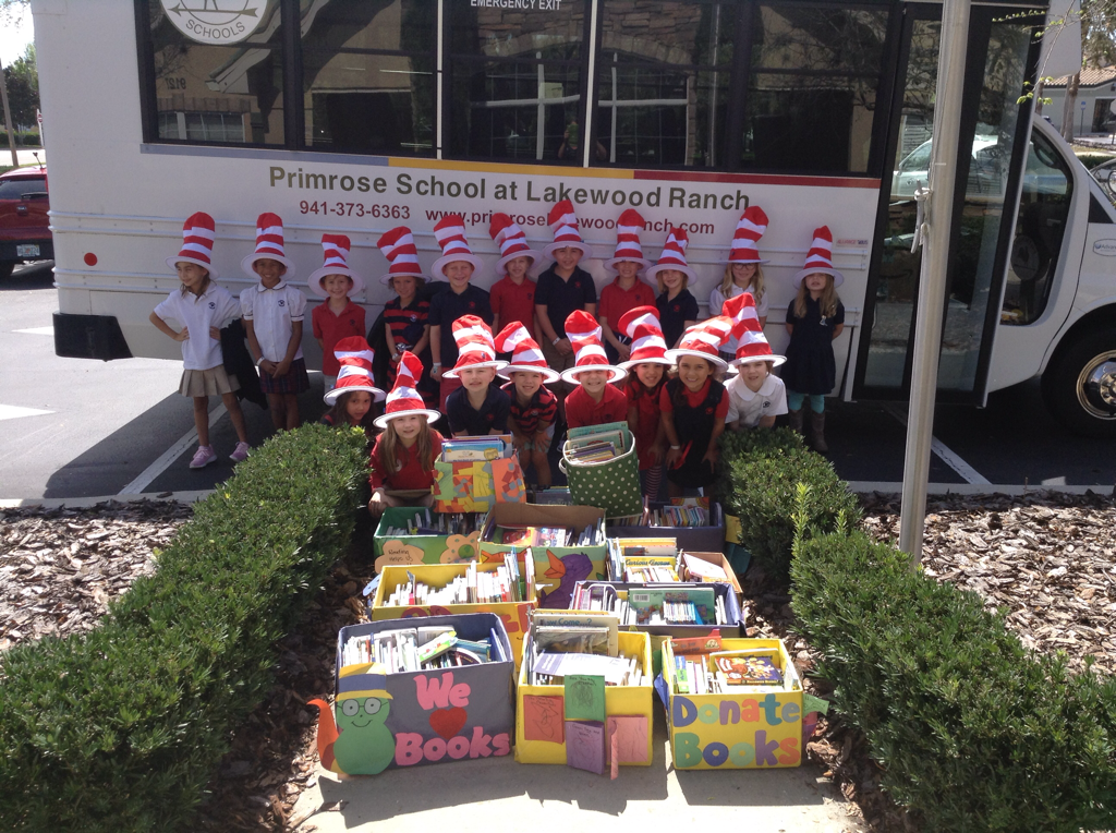 Photo of Private Kindergarten students posing with donated books