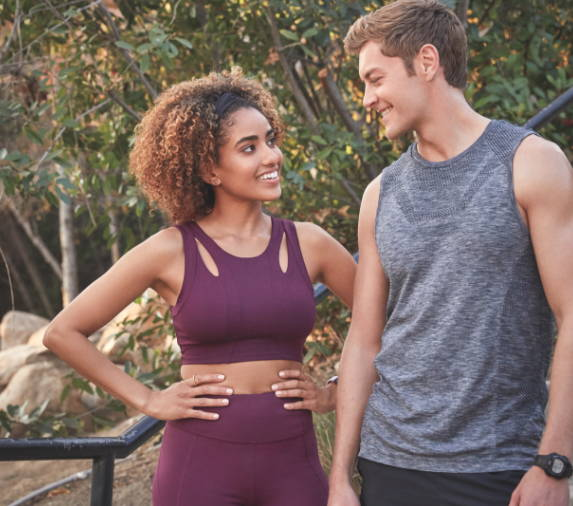 girl and boy in workout clothes smiling