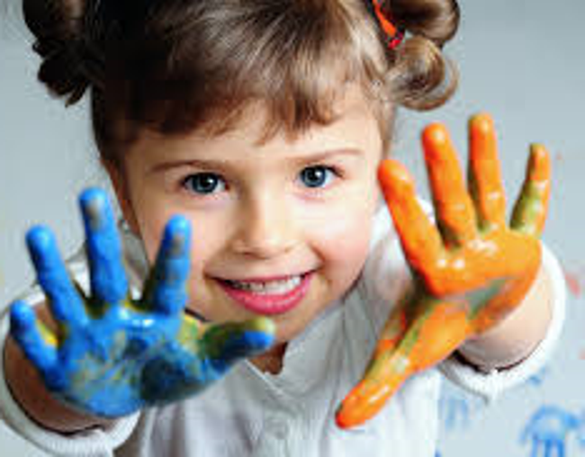 Little girl excitedly shows of her painted palms