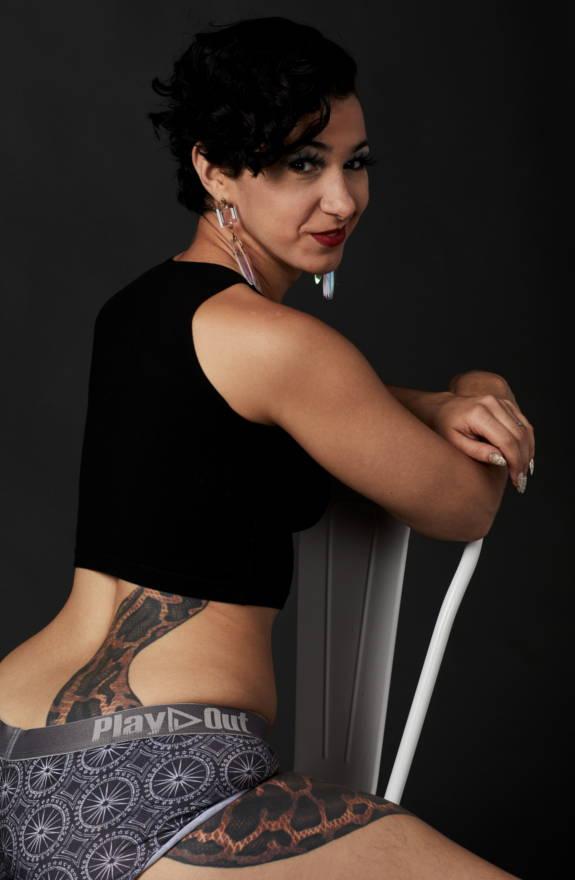 Female model wears kaleidoscope print boxer briefs underwear