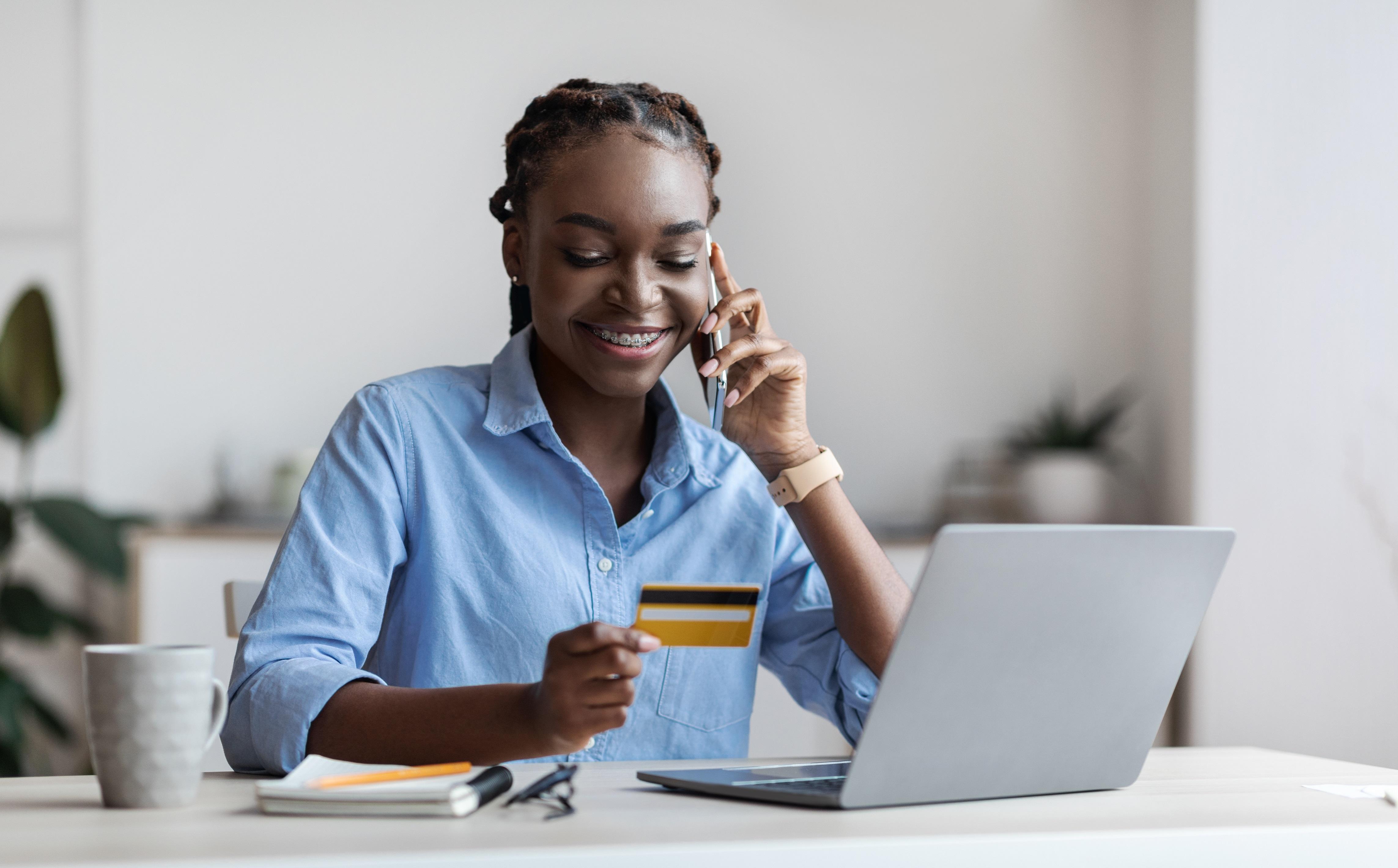 Smiling black female freelancer ordering online wi e5kce94