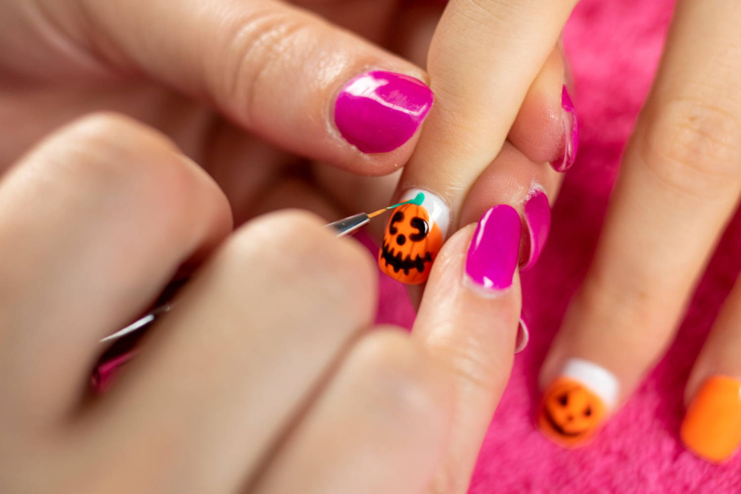 Pumpkin nails being finished with ORLY Hip & Outlandish stem detail