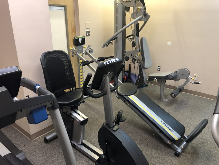 Open gym space with therapeutic equipment