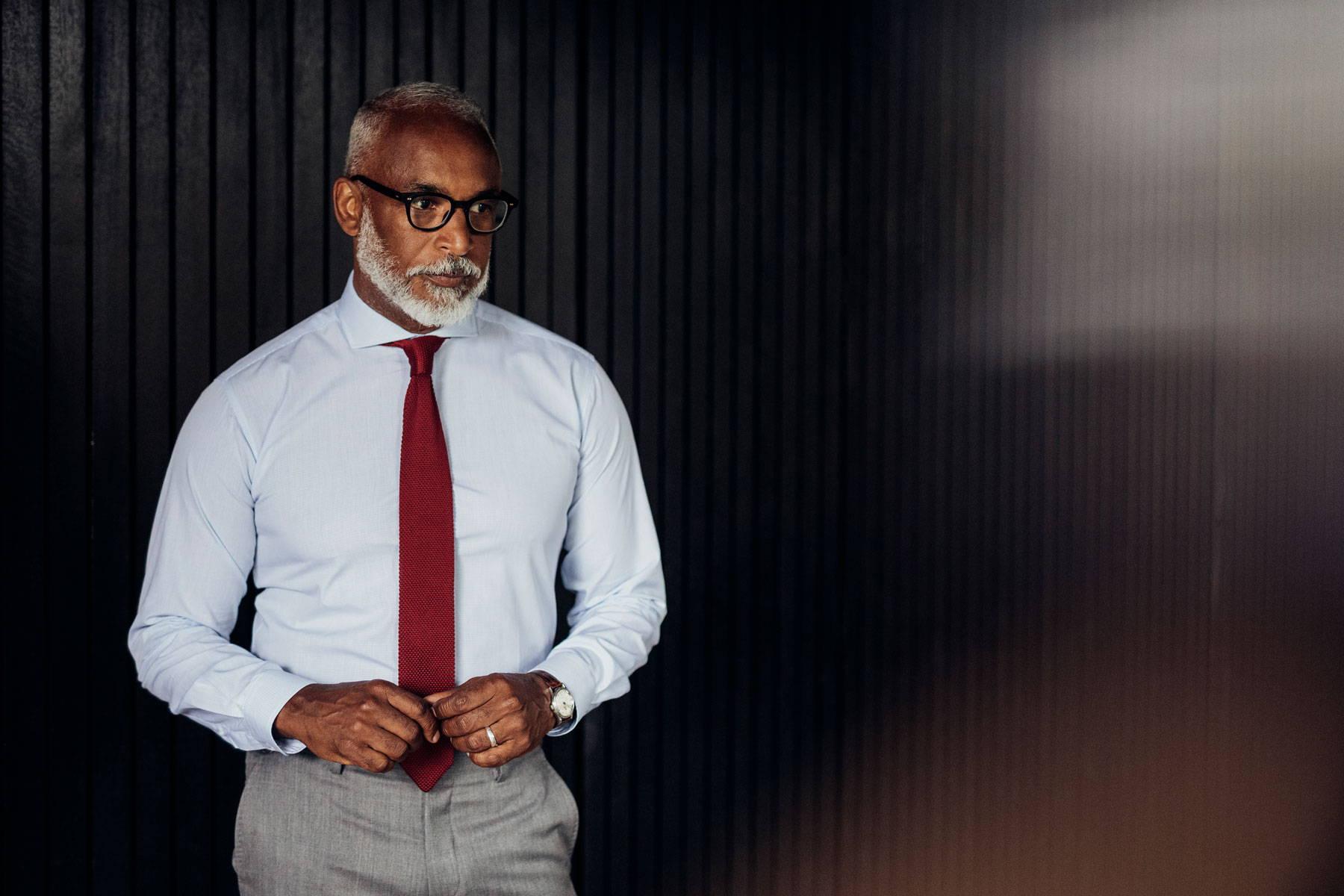 Man in light blue shirt and dark red tie