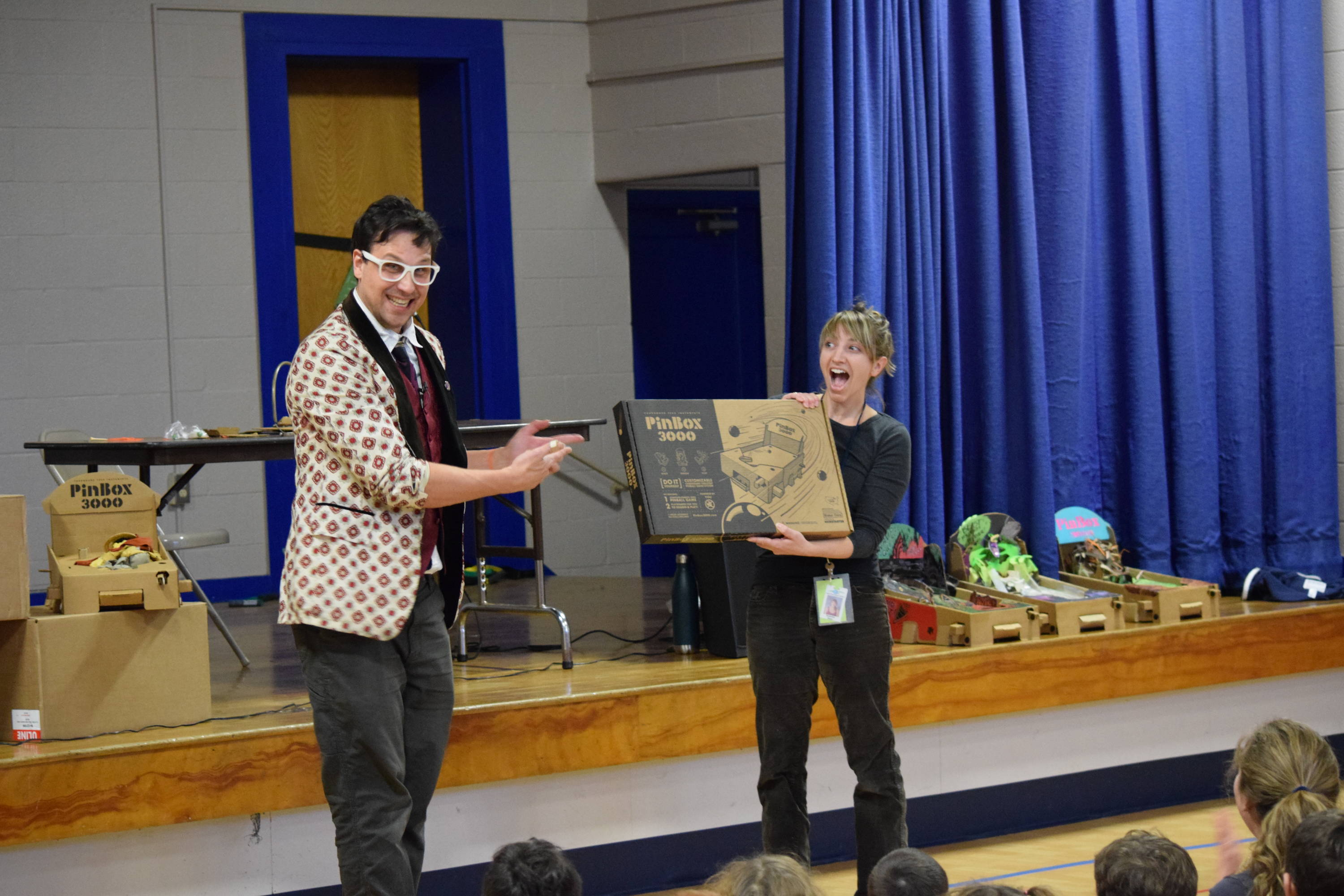 Ben gives art teacher Miss Blain a PinBox 3000.