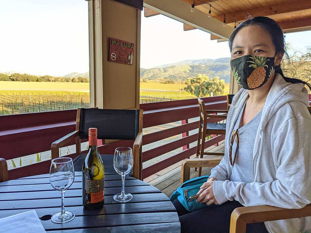 Woman sitting with wine at Kalyra Winery in Santa Ynez Valley
