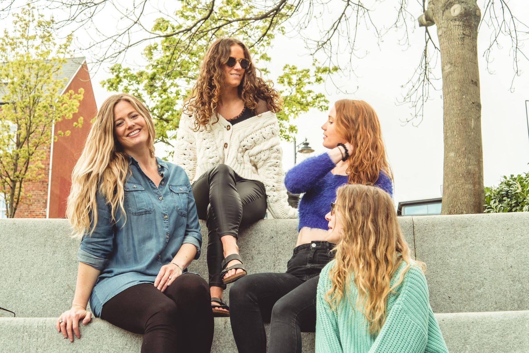 Image of girls sitting on steps
