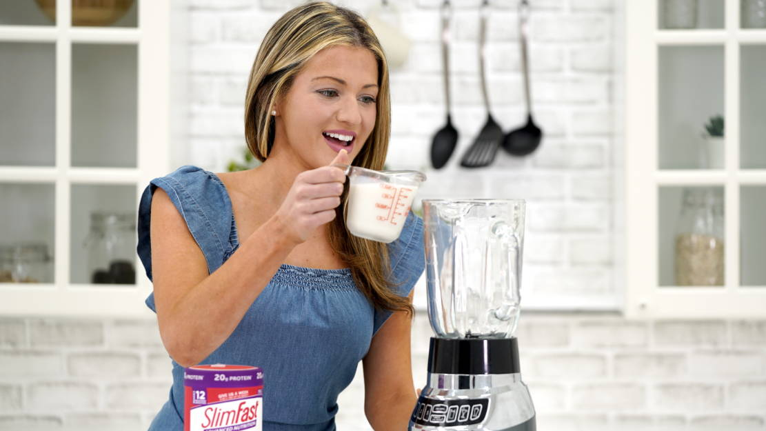 Lifestyle image of lady making a smoothie