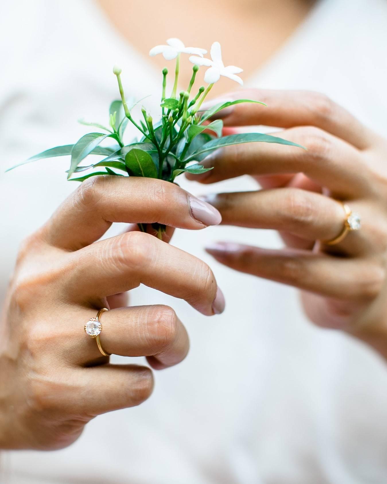 woman wearing diamond rings