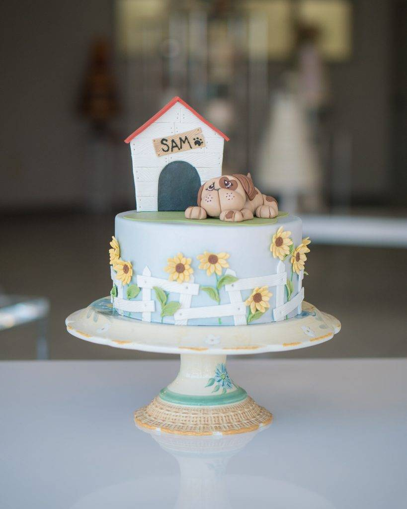 Cake with a dog, doghouse, and sunflowers on it. Perfect for birthdays or special occasions. Call to order yours today at House of Clarendon in Lancaster, PA
