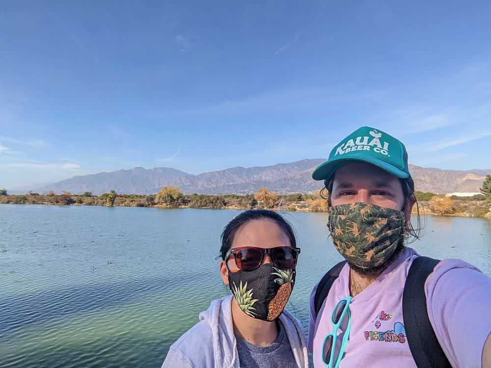 Young couple taking a selfie in front of the lake at Santa Fe Dam Recreation Area