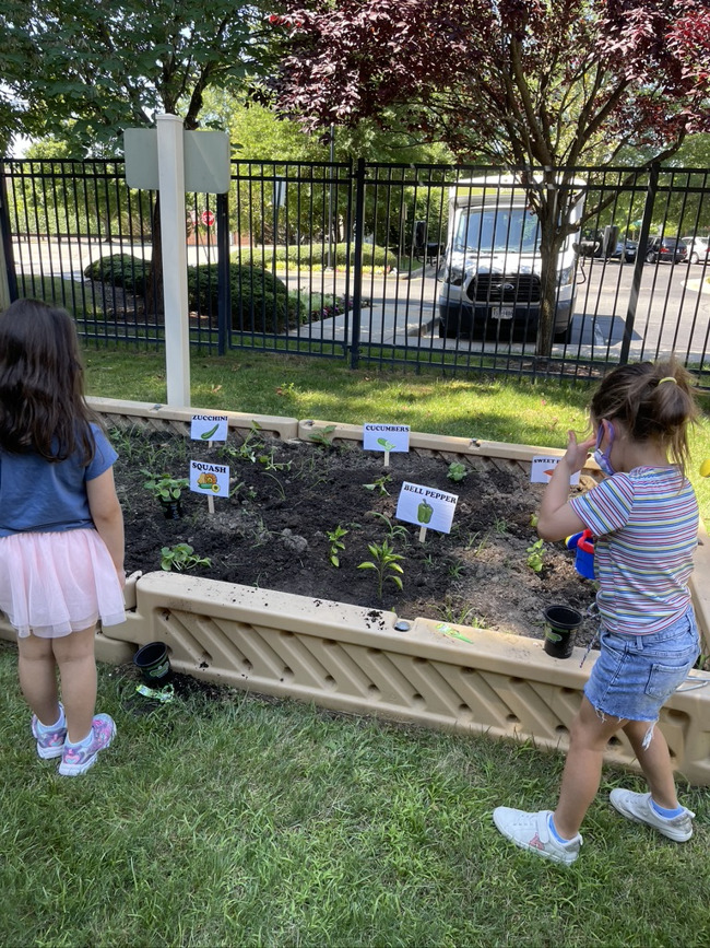Pre-K students helping in the garden!