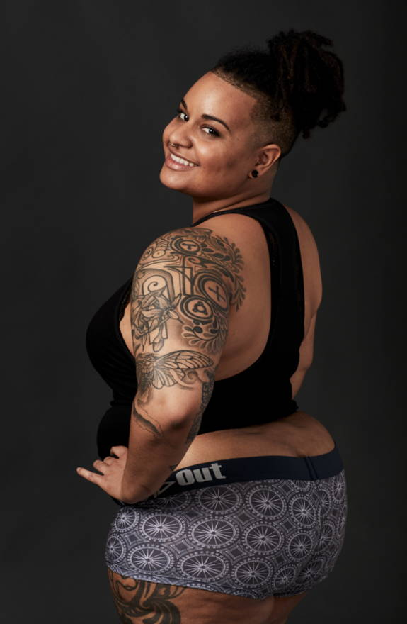 Plus-size African American model wears kaleidoscope print boxer briefs underwear.