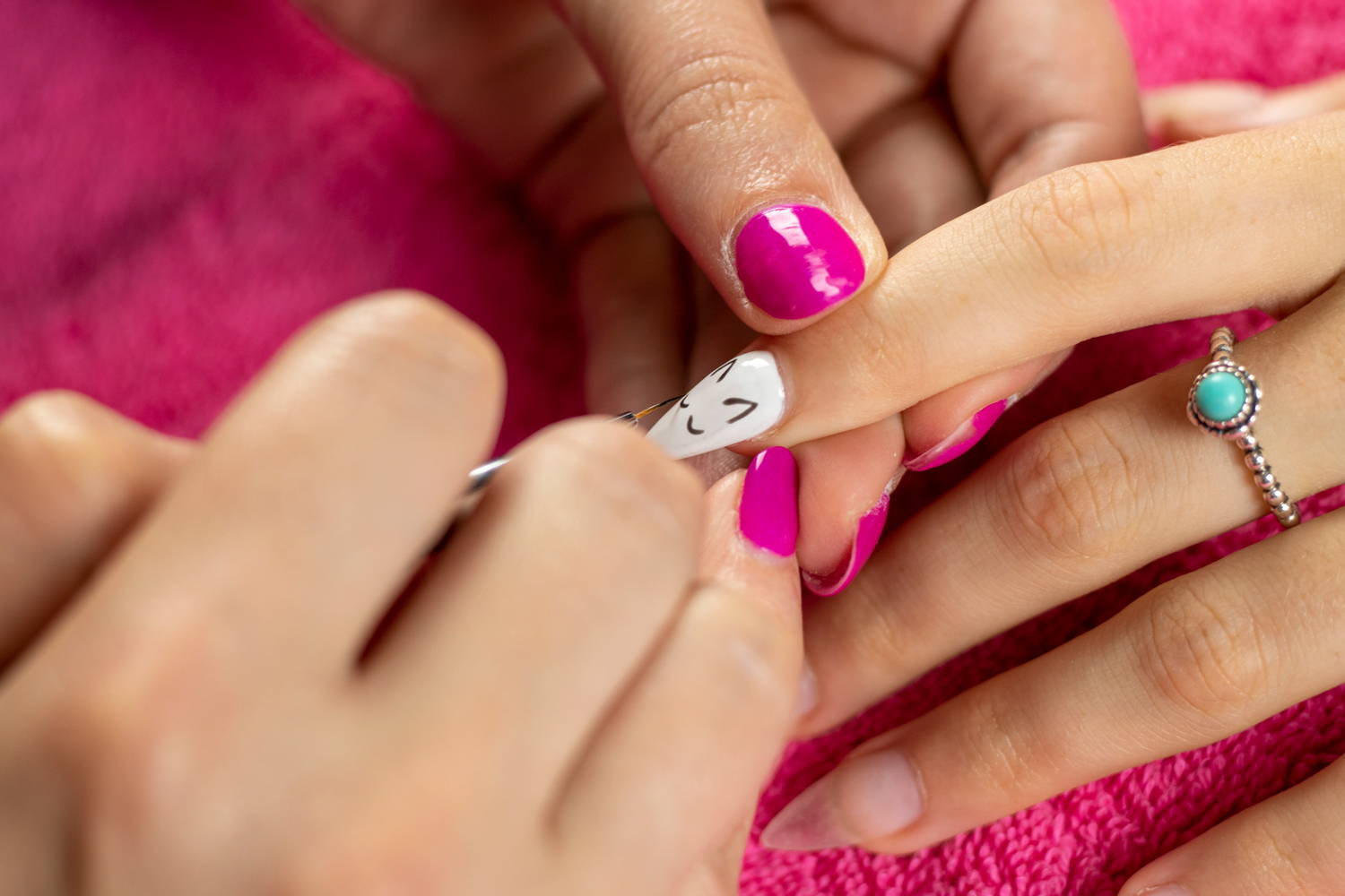 Unicorn nail art detail being painted onto a nail using ORLY GelFX Liquid Vinyl