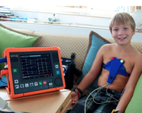 Jake demonstrates the boat's portable EKG.