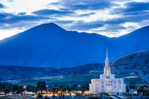 Payson Temple standing against blue mountains.