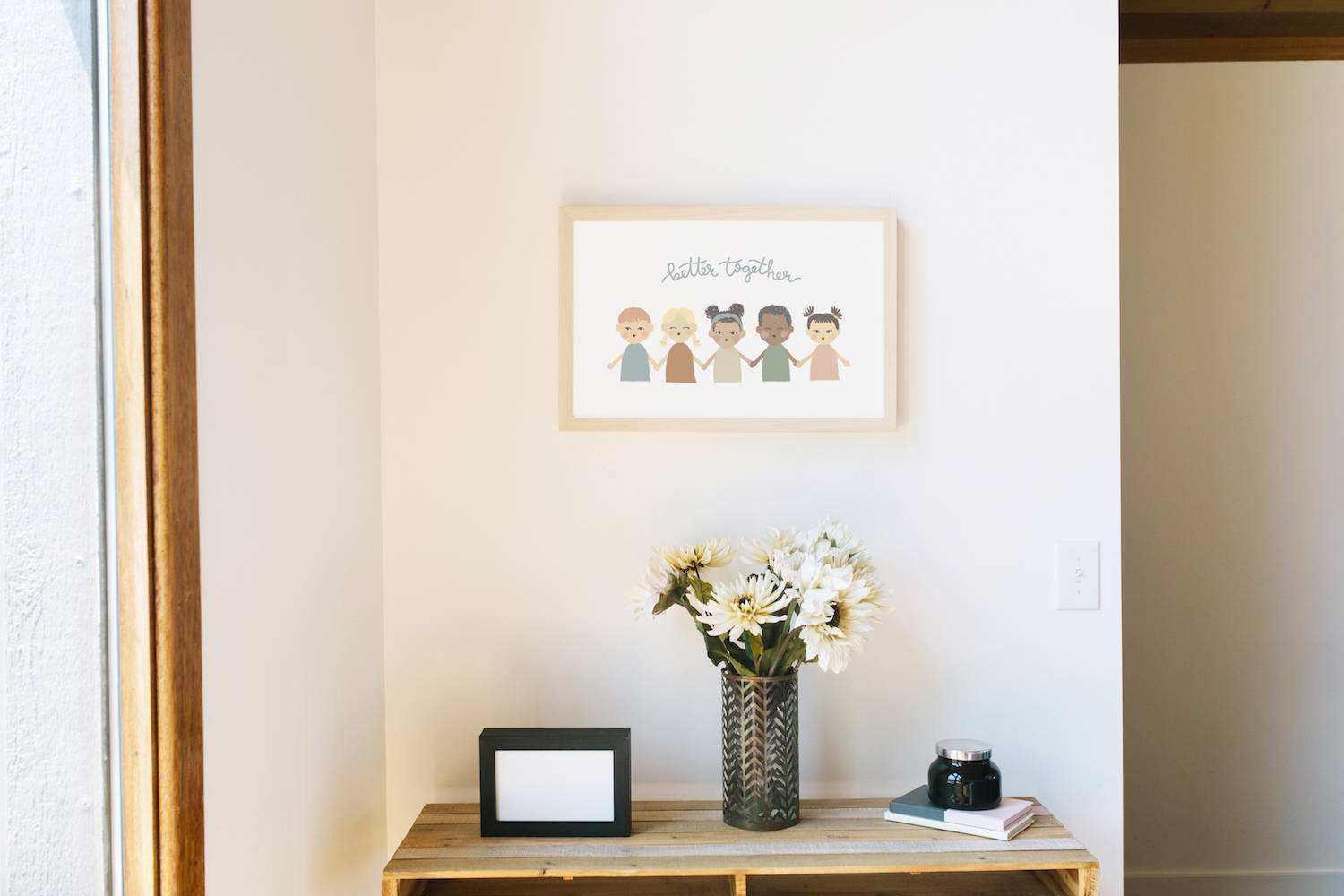 frame hanging on wall above bed
