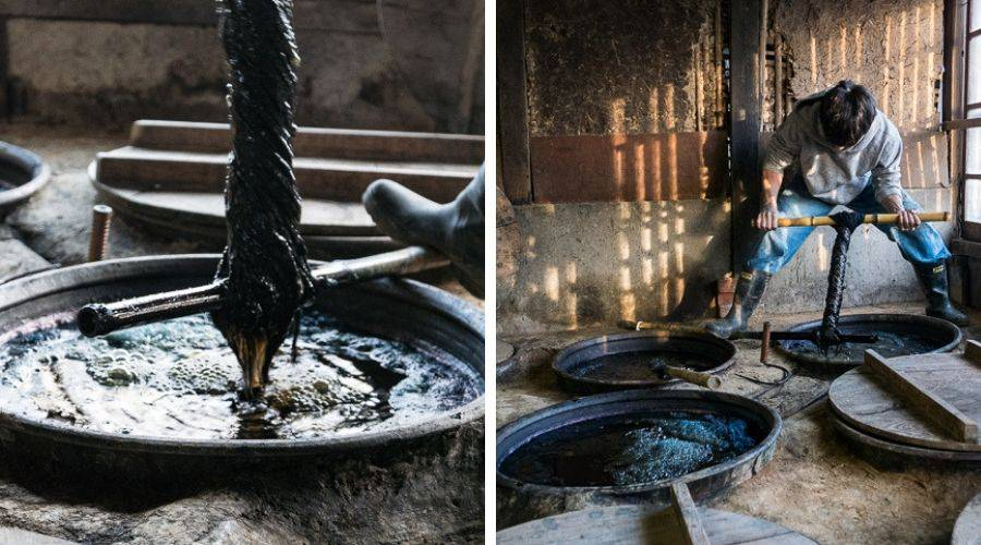 naturally fermented indigo production. Wool being dyed in vats