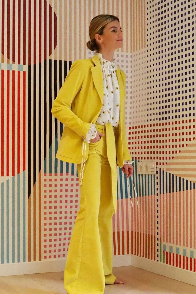Stylist and Spanish Influencer Patricia Sañes wears YOLKE's Primrose Stevie Blouse, and Sunshine Yellow Corduroy Hilary Jacket and Bow Jean
