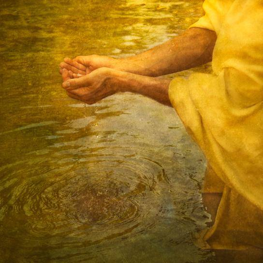 Jesus cupping river water in His hands.