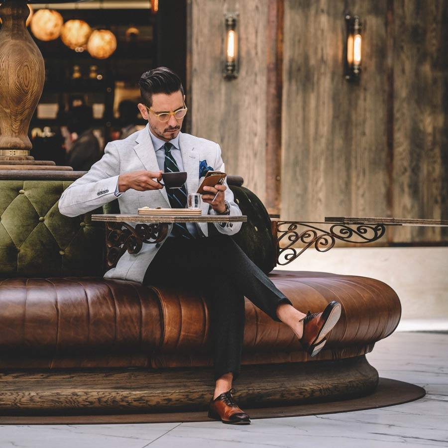 Man reading and drinking coffee using Inscribe Self product