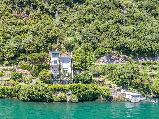 "Barcelona - Built in the 1960s and extensively refurbished, ""Villa Argegno"" is situated on Lake Como to the west of the region, between Como and Menaggio. It affords almost 740 square metres of living space, set over three floors and offers four bedrooms and bathrooms. Asking price: 8.5 million euros (Copyright: Engel & Völkers Cernobbio)"